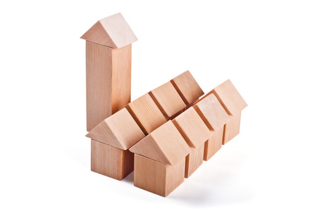 absorption: City and suburbs. Toy houses made of wooden cubes isolated on white background