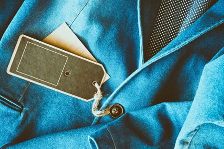 Empty tag brown color label on denim clothing Stock Photo