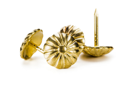 Decorative furniture nails for upholstery and drapery of furniture, close-up, on white background Stock Photo