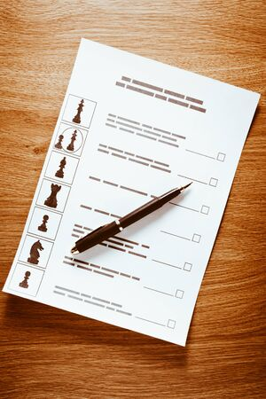 Election of the presidential candidate. Presidential elections. List of selections, put a tick, pen, pencil on wooden background Stock Photo