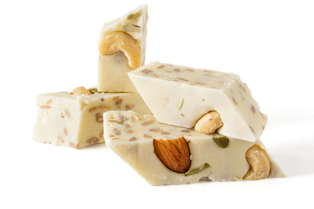 Oriental sweets, halva, sherbet with nuts and seeds close-up on a white background