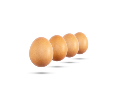 Eggs white and brown isolated on white frne