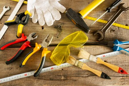 Tool for home repairs on the background of old wooden boards