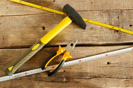Hand tools for home repairs on the background of old wooden boards Stok Fotoğraf