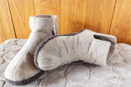 Felt soft-toe slippers that protect your feet from the cold Фото со стока