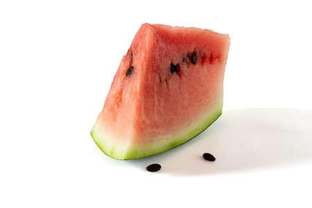 Slice of watermelon with seeds on a white background