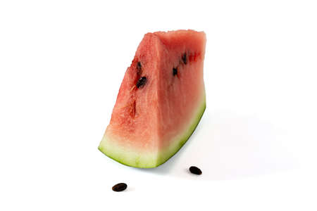 Slice of watermelon with seeds on a white background Фото со стока - 151575763