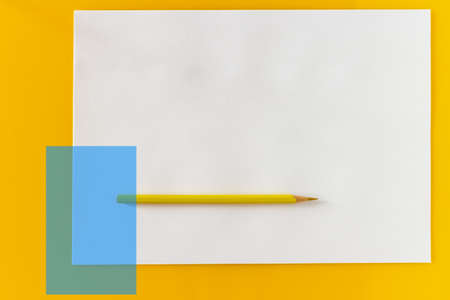 Yellow pencil and blank sheet of white paper on a yellow background Фото со стока - 152367906