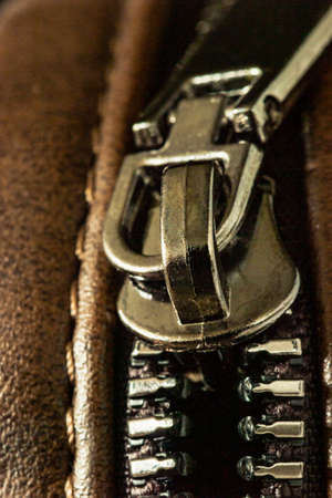 Close-up of a zip fastener with a lock on a leather product Фото со стока - 164758483