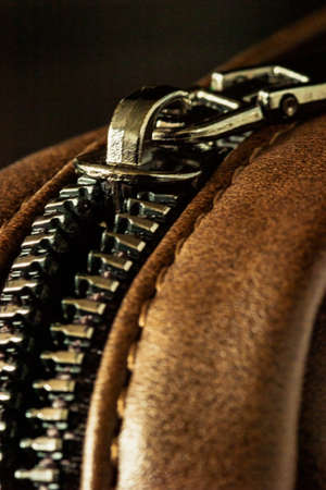 Close-up of a zip fastener with a lock on a leather product Фото со стока - 164758473