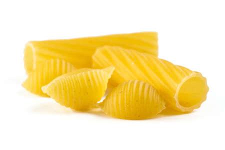 Tubular pasta with swirling wavy surface and shells isolated on white background Standard-Bild