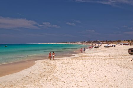Vacationers strolling on the beautiful sandy beach on the island of Sal, Cape Verde