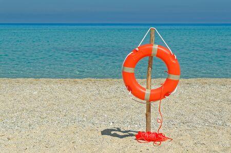Life buoy on the sandy beach