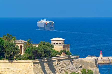 A ferry leaves a harbor of Malta