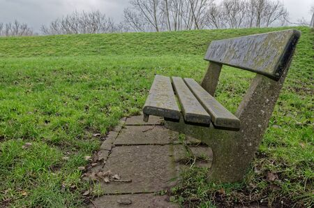 Close-up photo of a stone bench on a meadow, Hamburg, Germany