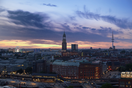 Hamburg's landmarks at sunset - Ferris Wheel of Hamburg's Dom, St. Michael's church and television tower