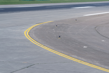 Runway curve at airport with yellow double line