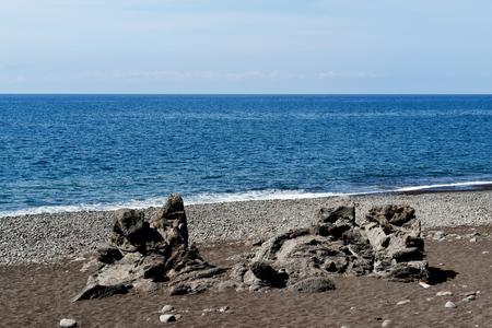Volcanic formation on a beach. Praia Formosa beach in Funchal on Madeira island, Portugal