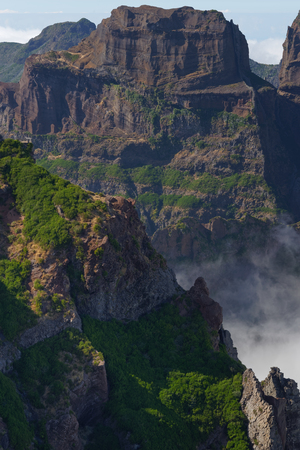 Amazing view on a mountain peak in the distant. View from Pico do Arieiro on Portuguese island of Madeira