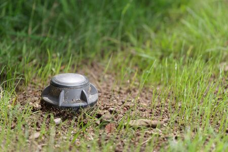 Closeup of an up sprinkler in a green lawn. Hamburg, Germany Stockfoto