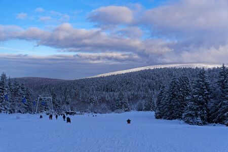 Toboggan piste in winter against cloudy sky. Torfhaus in Harz mountain national park, Germany