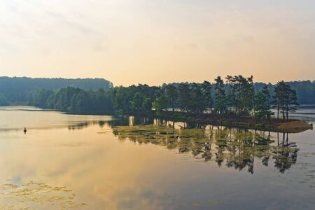 Panoramic scene of sunrise over Hiltruper lake. Muenster, Germany