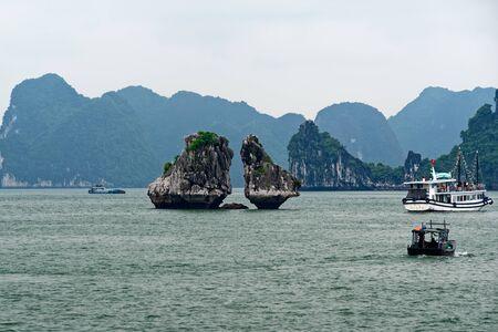 Hon Ga Choi Island (Fighting Cocks Island), or Trong Mai Island (Cock and Hen Island), Halong Bay, Vietnam. UNESCO World Heritage Site, famous destination of Vietnam