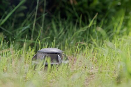 Closeup of an up sprinkler in a green lawn. Hamburg, Germany Banco de Imagens
