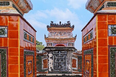 View on the spirit screen through exit from the gravesite. The gravesite is located in the Tu Duc Royal Tomb in Hue, Vietnam