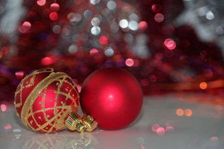 Close-up of two Christmas baubles against blurred background