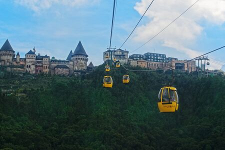 Da Nang, Vietnam - Mai 6, 2019: Cable car to Ba Na Hills Mountain Resort SunWorld, touristic complex with amusements, rides, attractions and restaurants