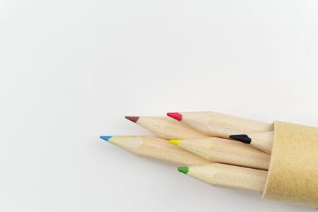 Set of colored pencils in a tube on white background 版權商用圖片