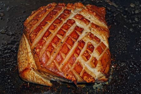 Directly above of ready roast pork with crackling 版權商用圖片