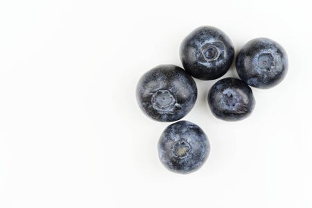 Directly above of fresh blueberries isolated on white background