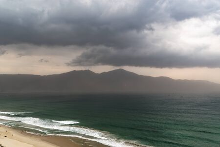 Panoramic view of Tho Quang with Dinh Ban Co mountain during stormy weather. Da Nang in Central Vietnam Standard-Bild