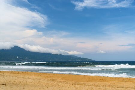 Panoramic view of Son Tra peninsula against sky on sunny day. Photo is taken from My Khe beach Da Nang, Cental Vietnam