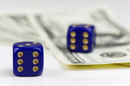 Two blue dices and American dollars on white background