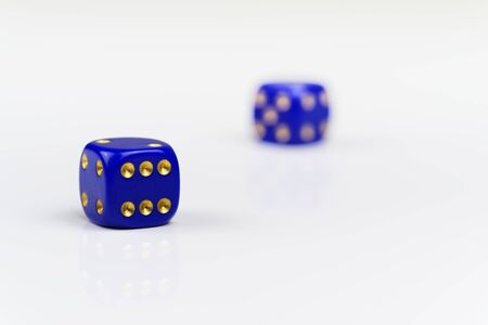 Two blue dices with gold colored points on white background