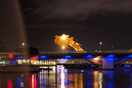 View of illuminated Dragon Bridge in Da Nang, Central Vientnam