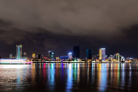 Night view of Han river and illuminated buildings in DaNang city, Vietnam