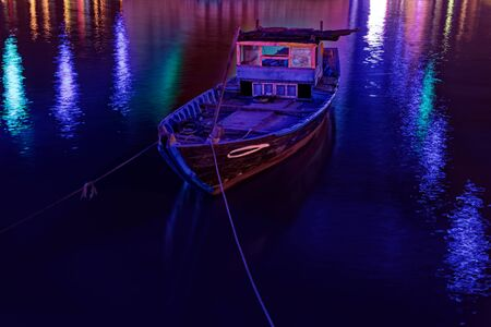 Traditional vietnamese fishing boat on the river at night. Da Nang, Vietnam Standard-Bild