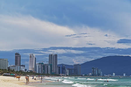 Da Nang, Vietnam - Mai 12, 2019: View of the seafront high-rise hotels on the south end of the golden sand beach My Khe (Danang beach) on sunny day
