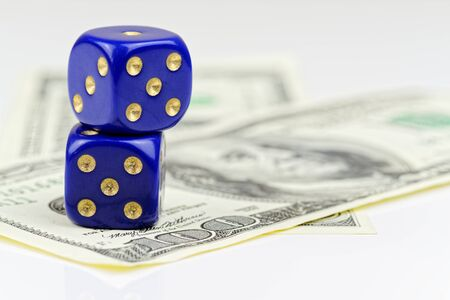 Two blue dices and american dollars on white background Standard-Bild - 144141010