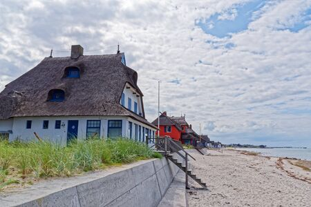 Historical villas in the nature reserve Graswarder on the beach in Heiligenhafen at the Baltic Sea, Germany