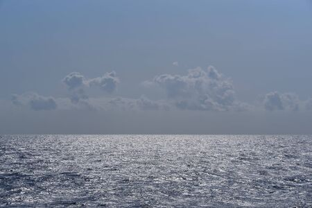Cloudy evening blue grey sky over the sea surface of the water Standard-Bild