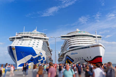 Tallinn, Estonia - August 12, 2019: Passengers getting off from cruise ships Aida Prima and Diamond Princess