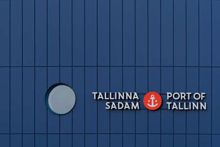 Tallinn, Estonia - August 12, 2019: Blue Building Facade of Port of Tallinn with label in Estonian and English