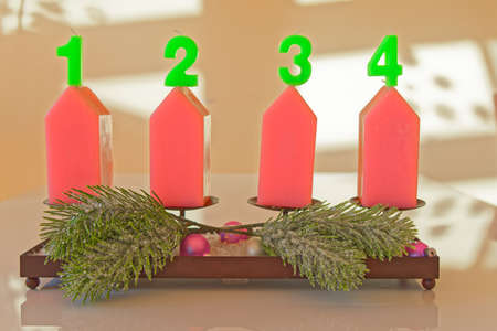 Christmas candles with numbers against bright background Standard-Bild