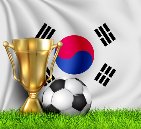 Golden realistic winner trophy cup and soccer ball isolated on national Korea South flag. National team is the winner of the football. Cup winner in the form of a golden bowl. Sport design background.