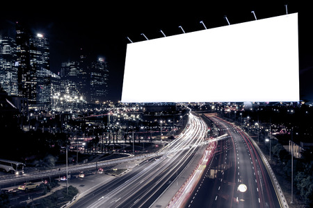 center city: blank billboard at night time for advertisement city street night light , colored filter. Stock Photo